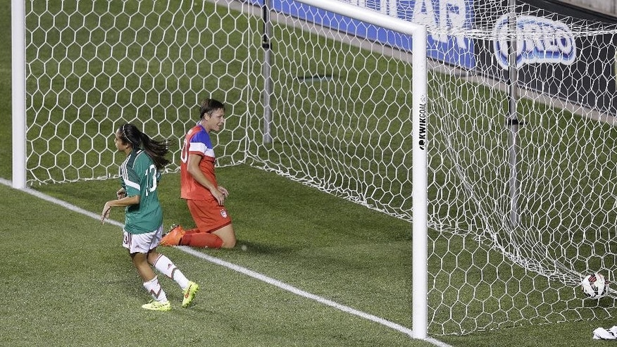 United States' Abby Wambach (20) looks on after scoring while Mexico defender Bianca Sierra (13) walks away in the first half of an international friendly soccer match at Rio Tinto Stadium Saturday, Sept. 13, 2014, in Sandy, Utah.  (AP Photo/Rick Bowmer)