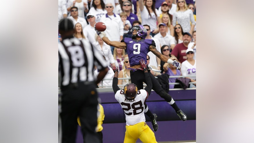 TCU wide receiver Josh Doctson (9) jumps to one-hand catch a touchdown pass over Minnesota defensive back Jalen Myrick (28) during the second quarter of an NCAA college football game, Saturday, Sept. 13, 2014, in Fort Worth, Texas. (AP Photo/LM Otero)