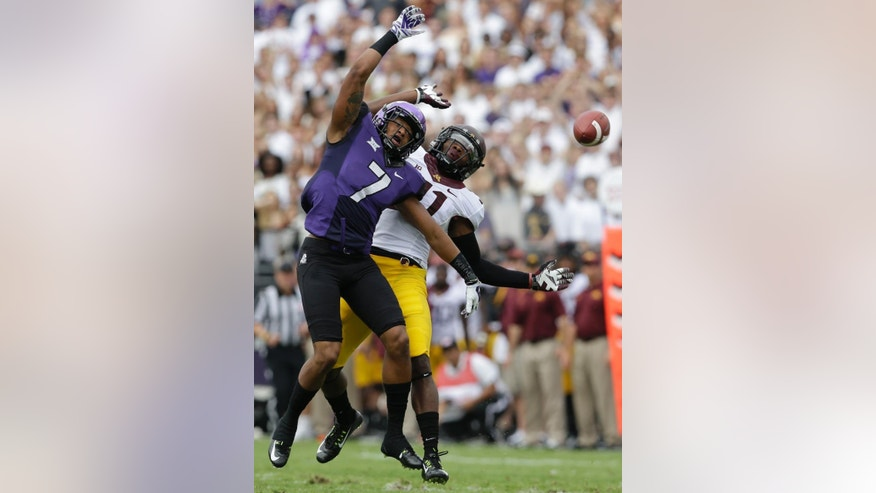 Minnesota defensive back Antonio Johnson (11) commits a pass play penalty against TCU wide receiver Kolby Listenbee (7) during the first half of an NCAA college football game Saturday, Sept. 13, 2014, in Fort Worth, Texas. (AP Photo/LM Otero)
