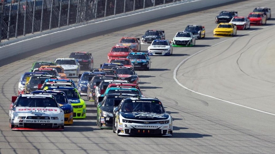 Brian Scott (2) leads the field during the NASCAR Nationwide Series Coca-Cola Race at Chicagoland Speedway in Joliet, Ill., Saturday, Sept. 13, 2014. (AP Photo/Paul J. Bergstrom)