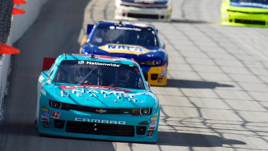 Kyle Larson (42) leads the field during the NASCAR Nationwide Series Coca-Cola Race at Chicagoland Speedway in Joliet, Ill., Saturday, Sept. 13, 2014. (AP Photo/Paul J. Bergstrom)