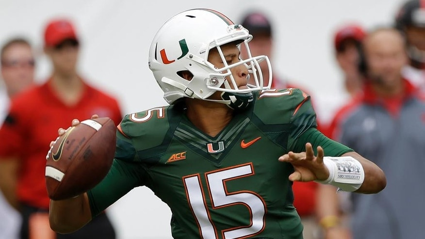 Miami quarterback Brad Kaaya (15) prepares to pass against Arkansas State in the first half of an NCAA college  football game in Miami Gardens, Fla., Saturday, Sept. 13, 2014. (AP Photo/Alan Diaz)