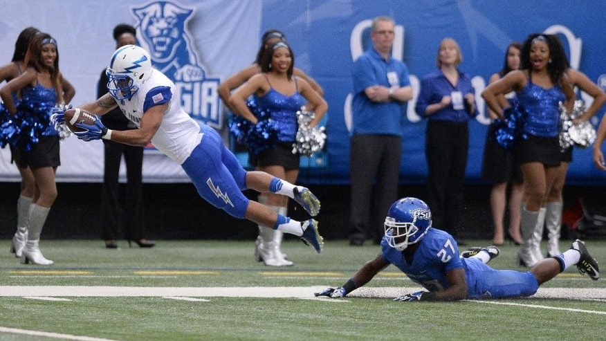 Air Force Devin Rushing (5) dives for the end zone after being hit by Georgia State's Bruce Dukes (27) during an NCAA college football game in Atlanta, Saturday, Sept. 13, 2014. (AP Photo/Johnny Crawford)