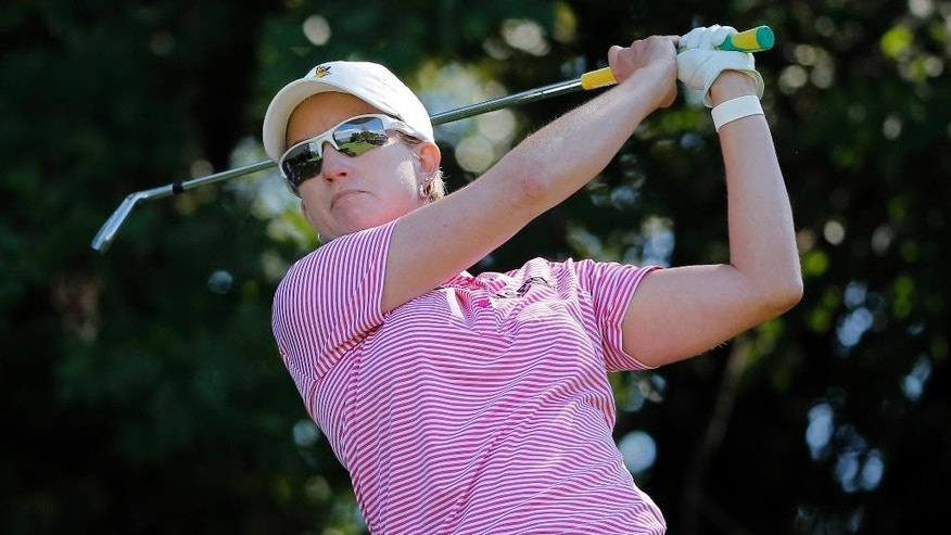 Karrie Webb of Australia watches the flight of her ball on the second hole during the third round of the Evian Championship women's golf tournament in Evian, eastern France, Saturday, Sept. 13, 2014. (AP Photo/Laurent Cipriani)