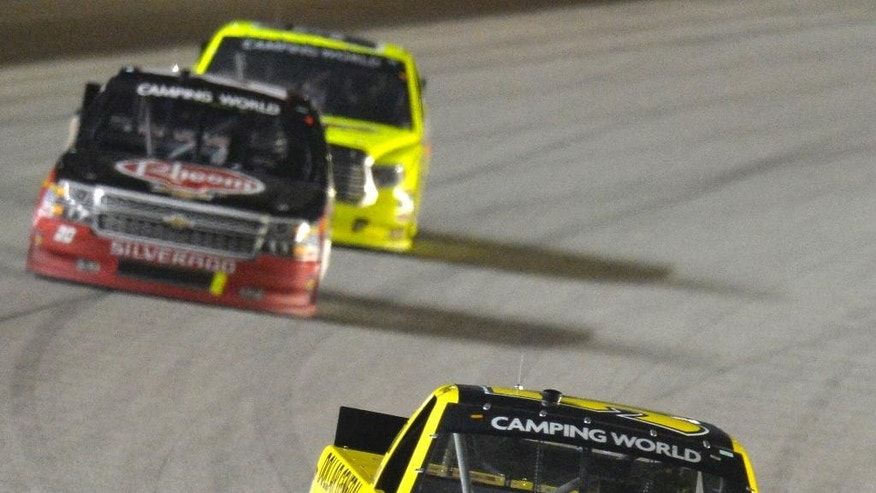 Kyle Busch (51) leads the field during the NASCAR Camping World Truck Series Lucas Oil 225 Race at Chicagoland Speedway in Joliet, Ill., Saturday, Sept. 13, 2014. (AP Photo/Paul J. Bergstrom)