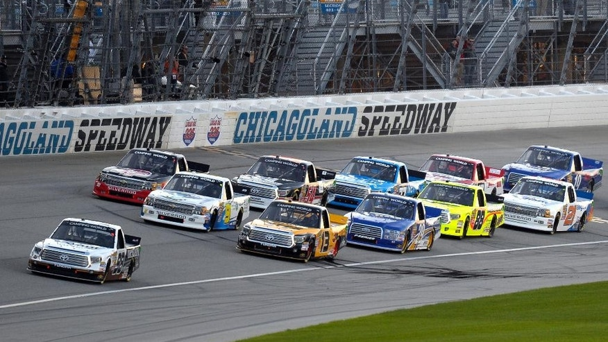 Johnny Sauter (98), left, leads the field at the start of the NASCAR Camping World Truck Series Lucas Oil 225 Race at Chicagoland Speedway in Joliet, Ill., Saturday, Sept. 13, 2014. (AP Photo/Paul J. Bergstrom)