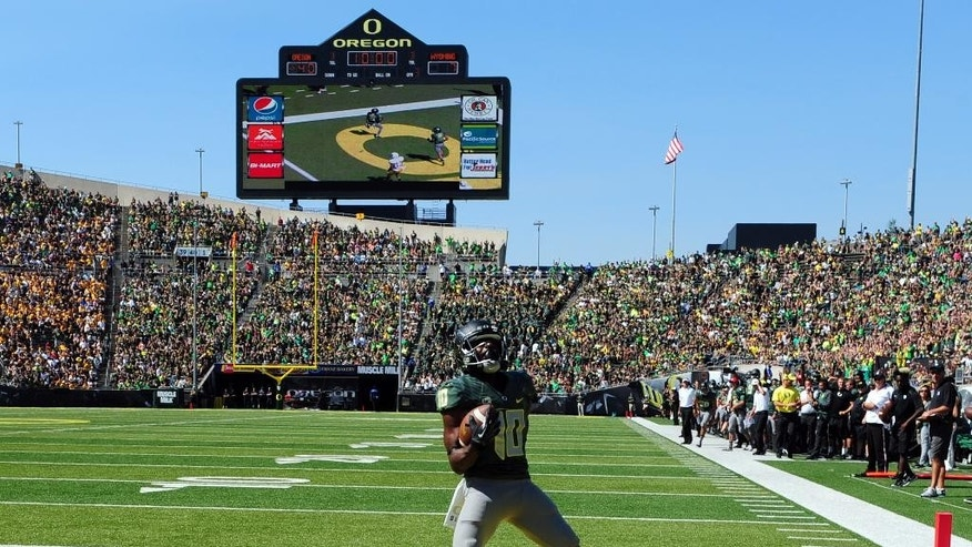Oregon wide receiver Johnathan Loyd (10) celebrates after scoring a touchdown during the third quarter of an NCAA college football game against Wyoming at Autzen Stadium on Saturday, Sept. 13, 2014, in Eugene, Ore. (AP Photo/Steve Dykes)