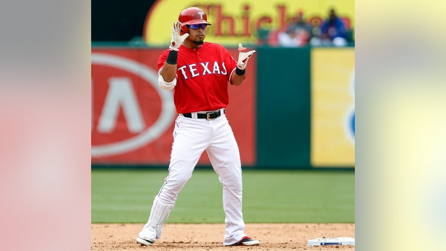 Texas Rangers second baseman Rougned Odor (12) claps his hands at second base, after hitting a double that scored two runs that put the Rangers ahead during the sixth inning of a baseball game, Saturday, Sept. 13, 2014, in Arlington, Texas. The Rangers won 3-2. (AP Photo/John F. Rhodes)
