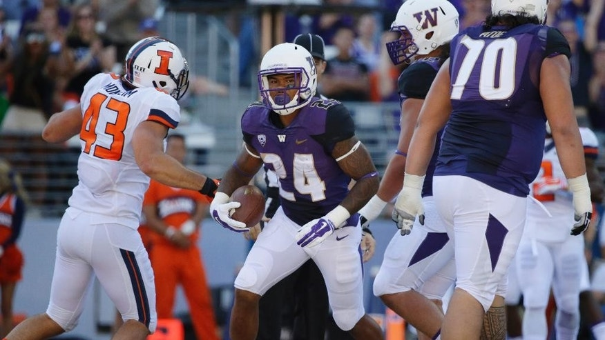 Washington running back Jesse Callierin (24) steps in for a touchdown against Illinois in the first half of an NCAA college football game, Sept. 13, 2014, in Seattle. (AP Photo/Ted S. Warren)