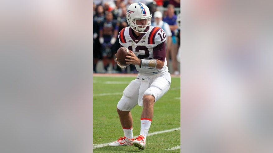 Virginia Tech quarterback Michael Brewer looks to pass during an NCAA college football game against East Carolina, Saturday, Sept. 13, 2014, in Blacksburg, Va. (AP Photo/Don Petersen)