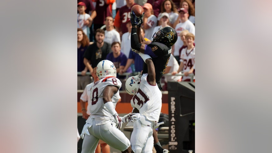 East Carolina's Cam Worthy (9) hauls in a long pass against Virginia Tech's Detrick Bonner (8) and Brandon Facyson during an NCAA college football game Saturday, Sept. 13, 2014, in Blacksburg, Va. (AP Photo/Don Petersen)