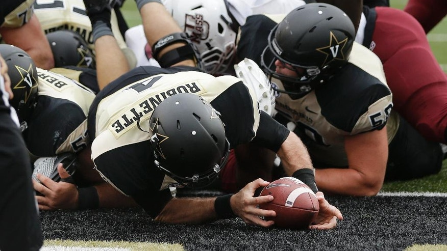 Vanderbilt quarterback Patton Robinette (4) dives into the end zone for a touchdown on a 1-yard run against Massachusetts in the second quarter of an NCAA college football game Saturday, Sept. 13, 2014, in Nashville, Tenn. (AP Photo/Mark Humphrey)