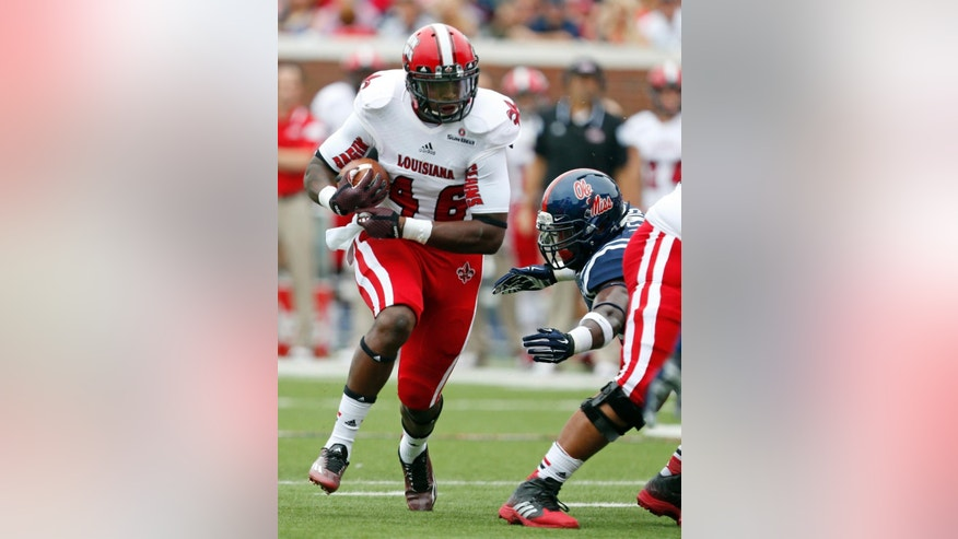 Louisiana-Lafayette running back Alonzo Harris (46) runs past a Mississippi defender for a first down during the first quarter at an NCAA college football game at Vaught-Hemingway Stadium in Oxford, Miss., Saturday, Sept. 13, 2014. (AP Photo/Rogelio V. Solis)