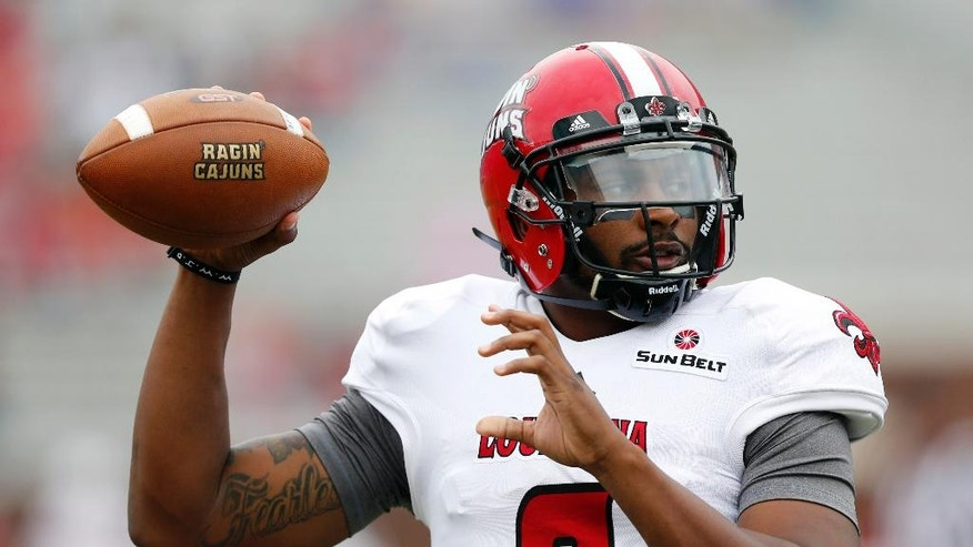 Louisiana-Lafayette quarterback Terrance Broadway (8) prepares to throw a pass during pre-game warmups against Mississippi at an NCAA college football game at Vaught-Hemingway Stadium in Oxford, Miss., Saturday, Sept. 13, 2014. (AP Photo/Rogelio V. Solis)