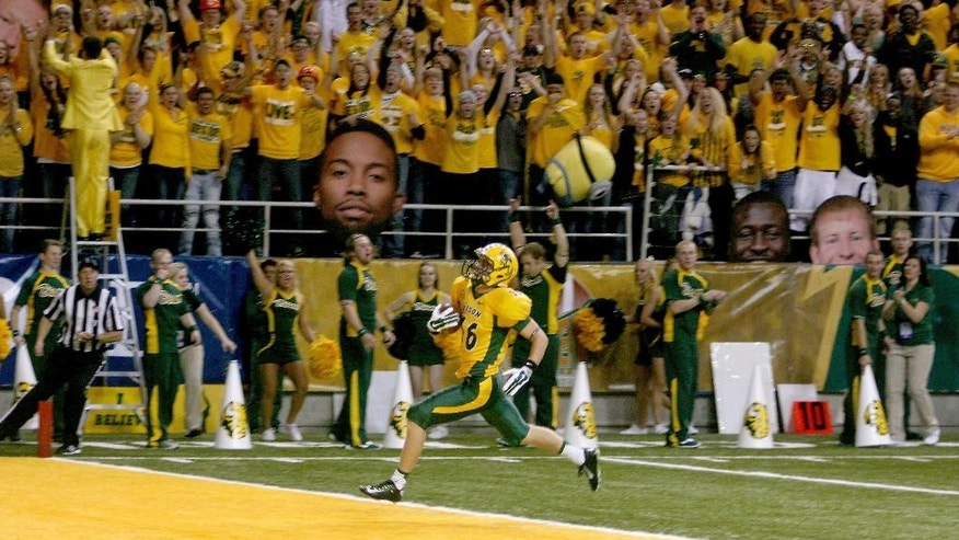 North Dakota State's  R.J. Urzendowski scores on an 80-yard pass from quarterback Carson Wentz in the first quarter of an NCAA college football game against Incarnate Word Saturday, Sept. 13, 2014, at Fargodome in Fargo, N.D. (AP Photo/Bruce Crummy)