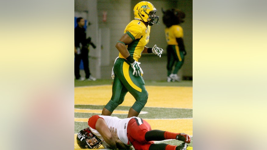 Incarnate Word punter Ramon Cote Jr., bottom, winces in pain after North Dakota State strong safety Chris Board (1) was called for roughing the kicker in the first half of an NCAA college football game Saturday, Sept. 13, 2014, at Fargodome in Fargo, N.D. (AP Photo/Bruce Crummy)