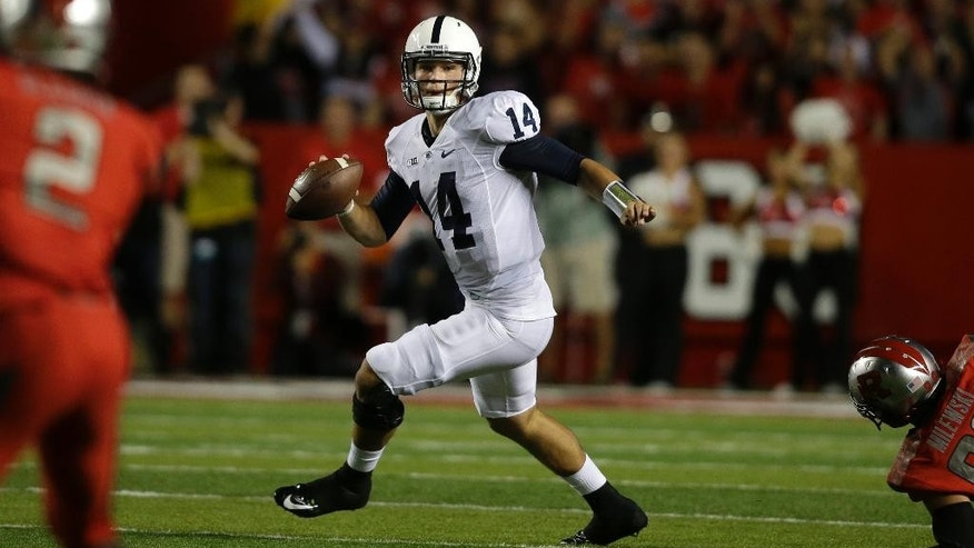 Penn State quarterback Christian Hackenberg (14) scrambles as he looks to throw a pass during the first quarter of an NCAA college football game against Rutgers, Saturday, Sept. 13, 2014, in Piscataway, N.J. (AP Photo/Mel Evans)