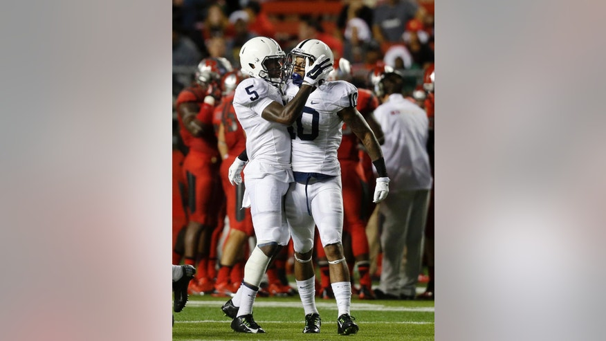 Penn State linebacker Nyeem Wartman (5) congratulates corner back Trevor Williams (10) on an interception during the first quarter of an NCAA college football game against Rutgers, Saturday, Sept. 13, 2014, in Piscataway, N.J. (AP Photo/Mel Evans)