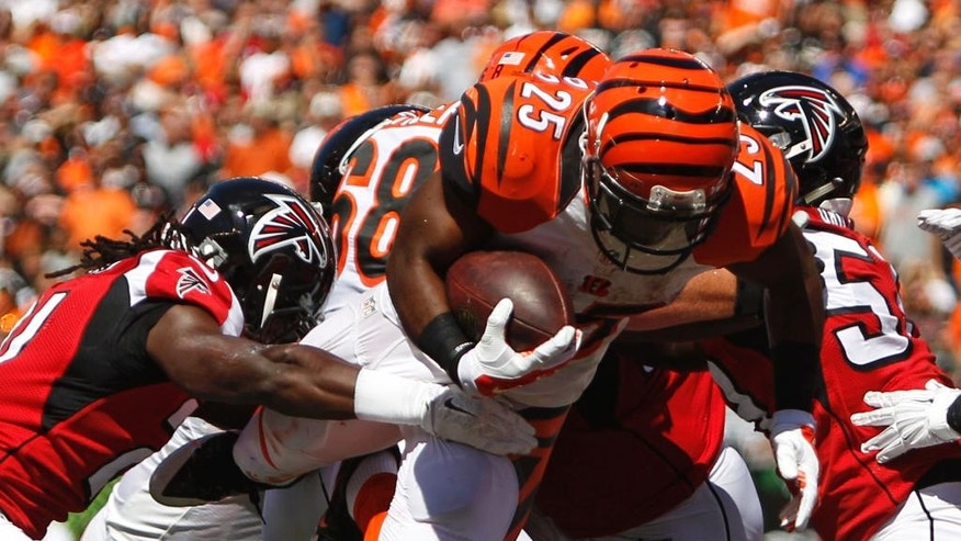 Cincinnati Bengals running back Giovani Bernard (25) dives into the end zone for a 4-yard touchdown in the first half of an NFL football game against the Atlanta Falcons, Sunday, Sept. 14, 2014, in Cincinnati. (AP Photo/Frank Victores)