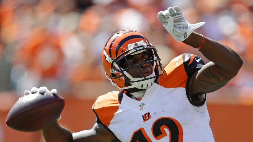 Cincinnati Bengals wide receiver Mohamed Sanu throws a 50-yard pass in the first half of an NFL football game against the Atlanta Falcons, Sunday, Sept. 14, 2014, in Cincinnati. (AP Photo/Michael Conroy)