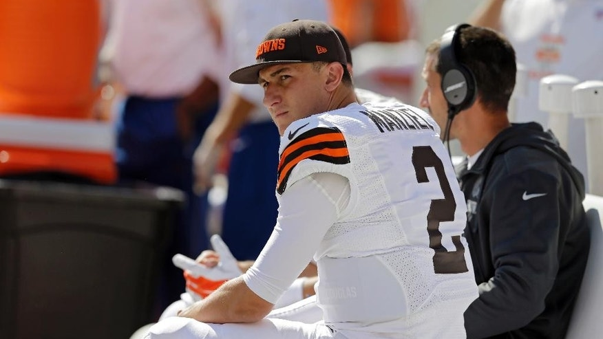 Cleveland Browns quarterback Johnny Manziel watches from the bench in the third quarter of an NFL football game against the New Orleans Saints, Sunday, Sept. 14, 2014, in Cleveland. (AP Photo/Tony Dejak)