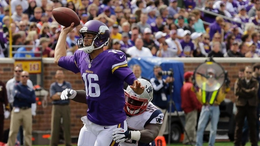 Minnesota Vikings quarterback Matt Cassel (16) throws under pressure from New England Patriots defensive tackle Chris Jones (94) and defensive end Chandler Jones during the second quarter of an NFL football game Sunday, Sept. 14, 2014, in Minneapolis. (AP Photo/Ann Heisenfelt)