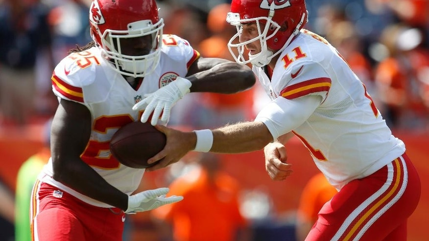 Kansas City Chiefs quarterback Alex Smith (11) and Jamaal Charles (25) warm up prior to an NFL football game against the Denver Broncos, Sunday, Sept. 14, 2014, in Denver. (AP Photo/Joe Mahoney)