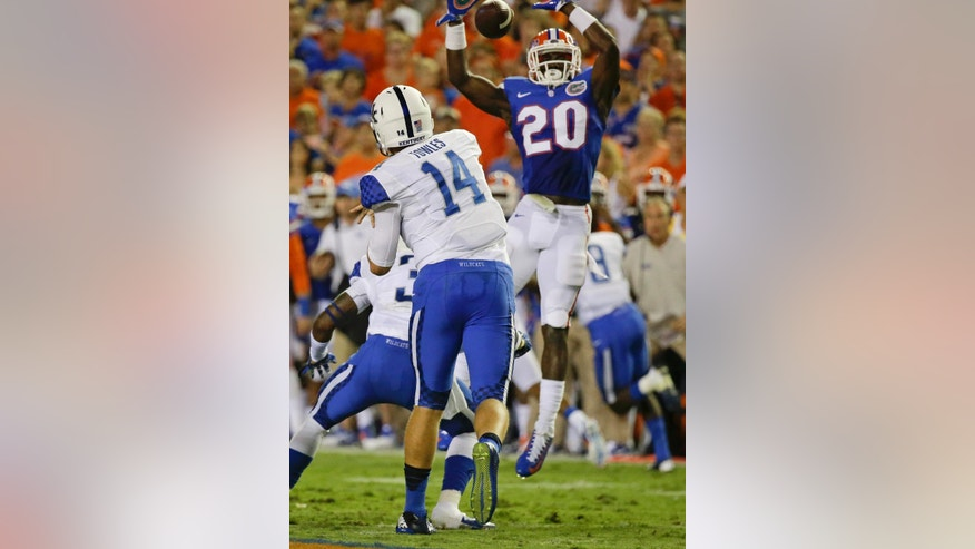 Florida defensive back Marcus Maye (20) knocks down a pass thrown by Kentucky quarterback Patrick Towles (14) during the first half of an NCAA college football game in Gainesville, Fla., Saturday, Sept. 13, 2014. (AP Photo/John Raoux)