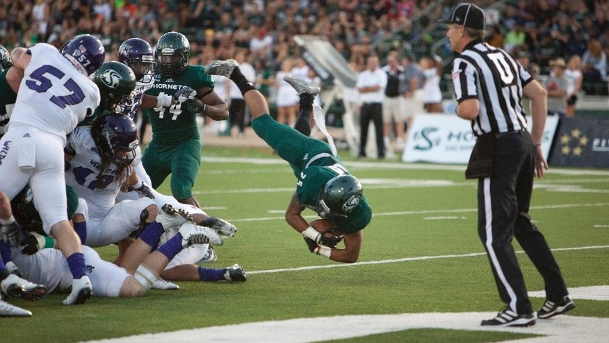 Sacramento State running back Jordan Robinson (25) dives over the goal for a touchdown against Weber State during the first half of an NCAA college football game in Sacramento, Calif., on Saturday, Sept. 13, 2014.(AP Photo/Steve Yeater)
