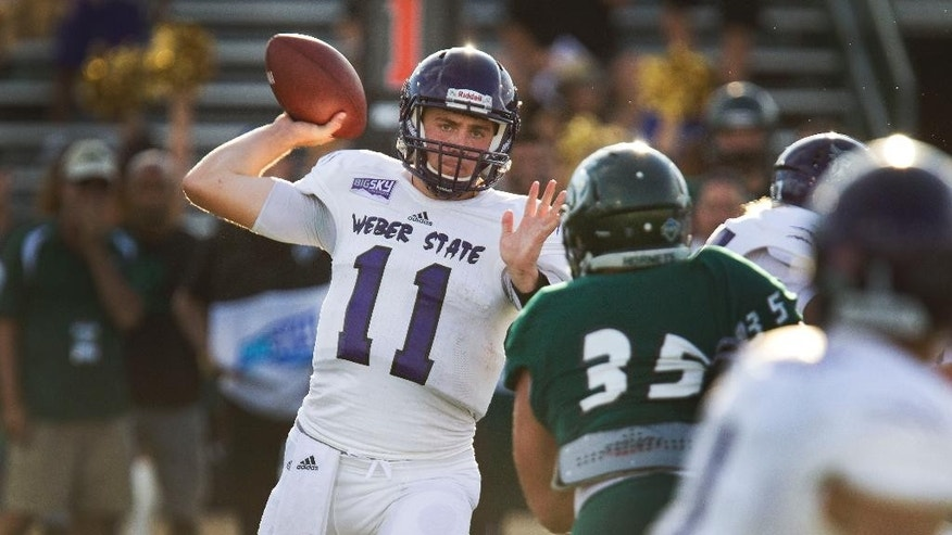 Weber State quarterback Billy Green (11) passes against Sacramento State during the first half of an NCAA college football game in Sacramento, Calif., on Saturday, Sept. 13, 2014.(AP Photo/Steve Yeater)
