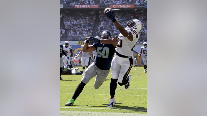 San Diego Chargers tight end Antonio Gates scores past Seattle Seahawks outside linebacker K.J. Wright during the second half of an NFL football game on Sunday, Sept. 14, 2014, in San Diego. (AP Photo/Gregory Bull)