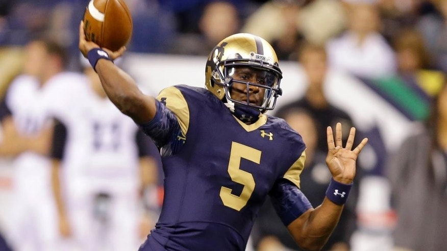 Notre Dame quarterback Everett Golson throws against Purdue during the first half of an NCAA college football game in Indianapolis, Saturday, Sept. 13, 2014. (AP Photo/Michael Conroy)