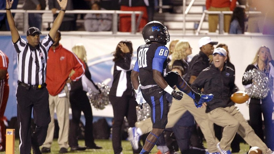 Middle Tennessee wide receiver Ed'Marques Batties (80) celebrates after scoring the game-winning touchdown against Western Kentucky on a 25-yard pass in the third overtime period in an NCAA college football game Saturday, Sept. 13, 2014, in Murfreesboro, Tenn. Middle Tennessee won 50-47. (AP Photo/Mark Humphrey)