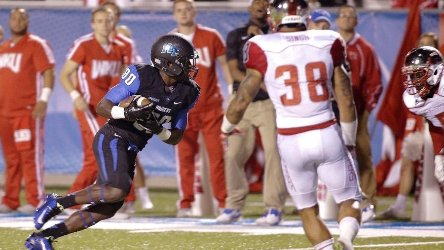 Middle Tennessee wide receiver Ed'Marques Batties (80) scores the game-winning touchdown on a 25-yard pass against Western Kentucky during the third overtime period in an NCAA college football game Saturday, Sept. 13, 2014, in Murfreesboro, Tenn. Middle Tennessee won 50-47 in triple overtime. Defending for Western Kentucky is defensive back Ricardo Singh (38). (AP Photo/Mark Humphrey)
