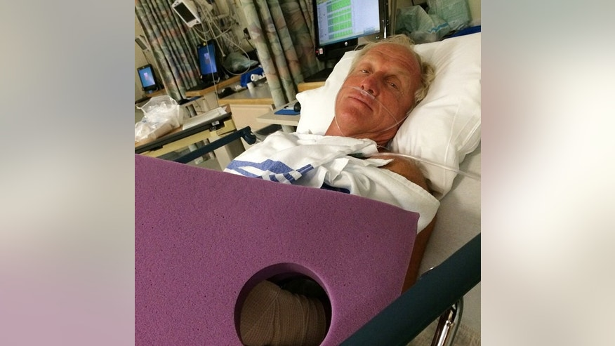 This photo provided by Greg Norman shows Norman resting in a hospital bed after a chainsaw accident.  Norman posted a photo to Instagram on Sunday, Sept. 14, 2014,  in which he was laying in a hospital bed with his left arm  heavily bandaged.  The Hall of Fame golfer and entrepreneur, was cutting back trees in his South Florida home when the weight of a branch pulled his left hand toward the chain saw. He said the blade hit him just below where a person would be wearing a wrist watch. He said doctors told him it missed his artery by a fraction of an inch. (AP Photo/Courtesy of Greg Norman) NO SALES