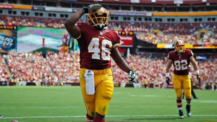 Washington Redskins running back Alfred Morris (46) celebrates his touchdown during the first half of an NFL football game against the Jacksonville Jaguars, Sunday, Sept. 14, 2014, in Landover, Md. (AP Photo/Evan Vucci)