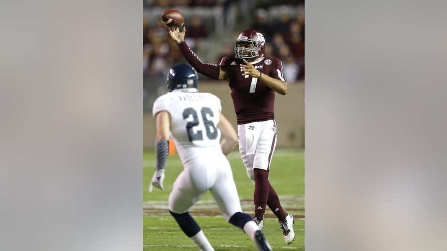 Texas A&M quarterback Kenny Hill (7) throws a pass as Rice linebacker James Radcliffe (26) defends during the second quarter of an NCAA college football game Saturday, Sept. 13, 2014, in College Station, Texas. (AP Photo/David J. Phillip)