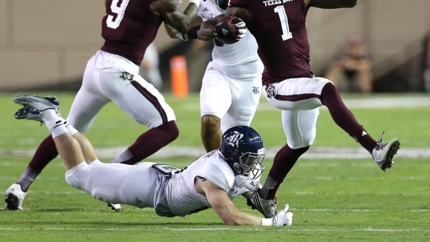 Texas A&M running back Brandon Williams (1) breaks away form Rice safety Garrett Fuhrman, left, during the second quarter of an NCAA college football game Saturday, Sept. 13, 2014, in College Station, Texas. (AP Photo/David J. Phillip)