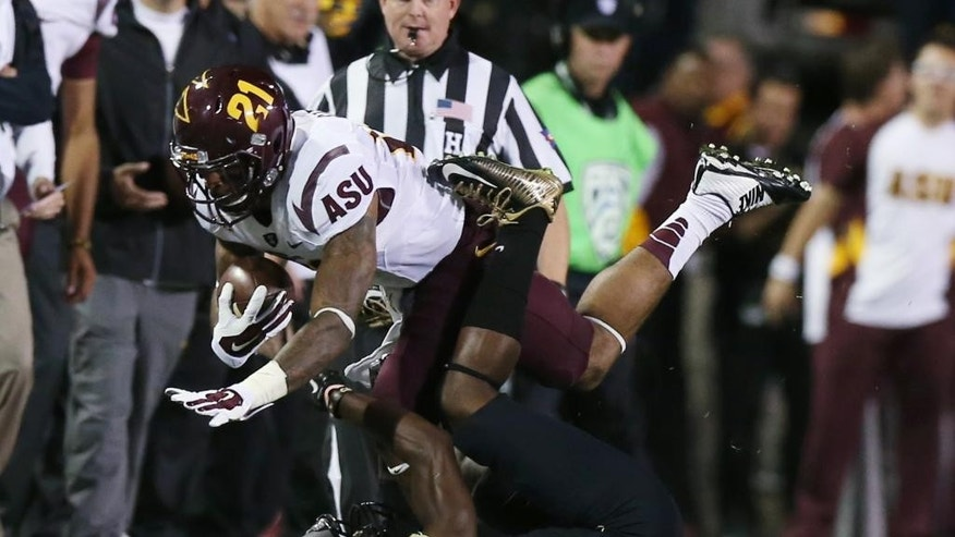 Arizona State wide receiver Jaelen Strong, top, is stopped after pulling a pass by Colorado defensive back Chidobe Awuzie in the first quarter of an NCAA college football game in Boulder, Colo., on Saturday, Sept. 13, 2014. (AP Photo/David Zalubowski)