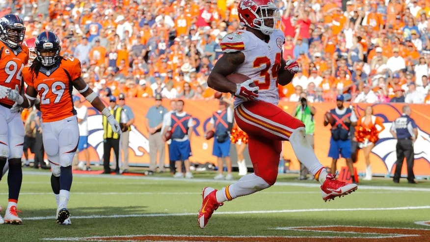 Kansas City Chiefs running back Knile Davis (34) scores against the Denver Broncos during the second half of an NFL football game, Sunday, Sept. 14, 2014, in Denver. (AP Photo/Jack Dempsey)