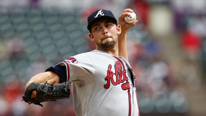 Atlanta Braves starting pitcher Mike Minor delivers a pitch to the Texas Rangers during the first inning of a baseball game, Sunday, Sept. 14, 2014, in Arlington, Texas. (AP Photo/Jim Cowsert)