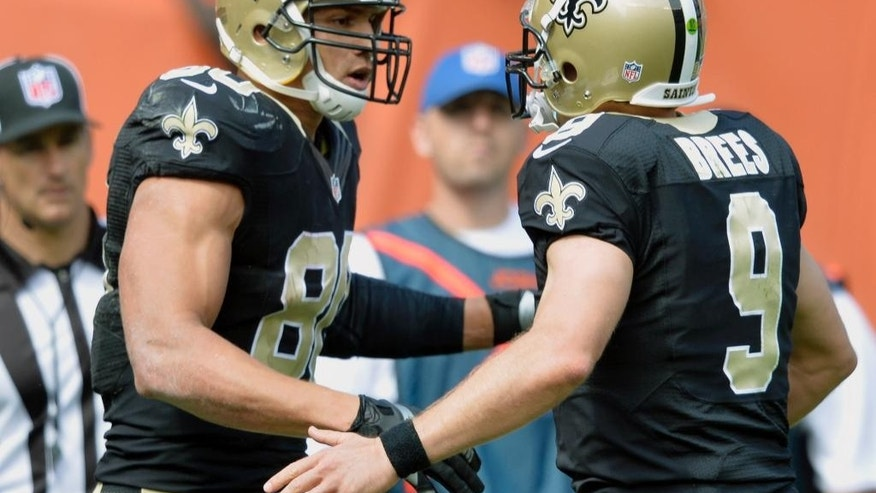 New Orleans Saints tight end Jimmy Graham (80) is congratulated by quarterback Drew Brees (9) after they connected on a 9-yard touchdown against the Cleveland Browns in the second quarter of an NFL football game Sunday, Sept. 14, 2014, in Cleveland. (AP Photo/David Richard)