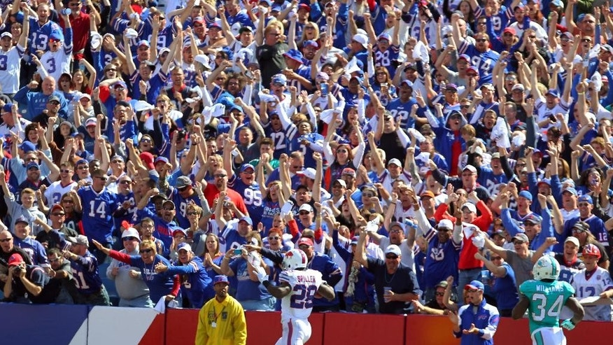 Buffalo Bills running back C.J. Spiller (28) returns a kickoff for a touchdown during the second half of an NFL football game Sunday, Sept. 14, 2014, in Orchard Park, N.Y. (AP Photo/Bill Wippert)
