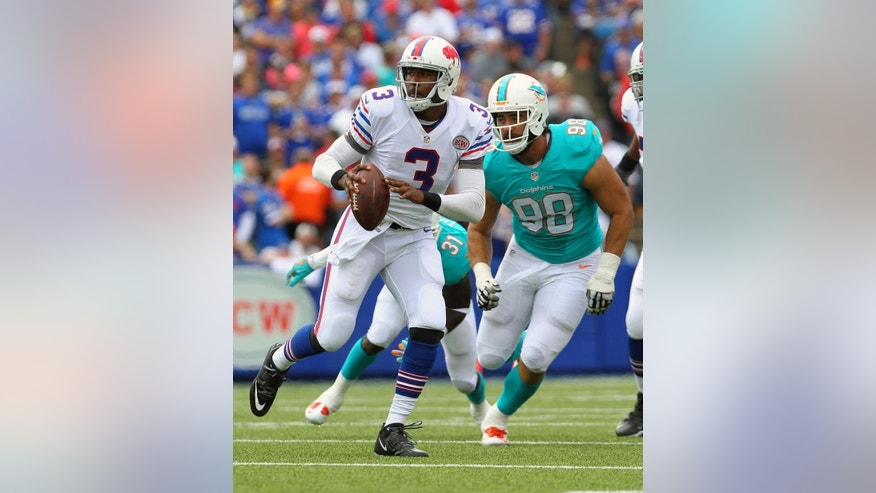 Buffalo Bills quarterback EJ Manuel (3) is pressured by Miami Dolphins defensive tackle Jared Odrick (98) during the first half of an NFL football game on Sunday, Sept. 14, 2014, in Orchard Park, N.Y. (AP Photo/Bill Wippert)