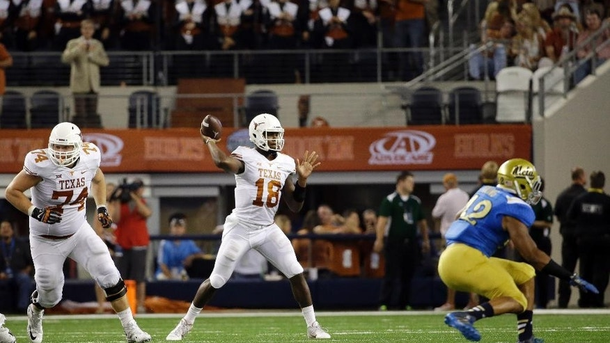 Texas quarterback Tyrone Swoopes (18) passes against UCLA during the second half of an NCAA college football game, Saturday, Sept. 13, 2014, in Arlington, Texas. (AP Photo/Tony Gutierrez)