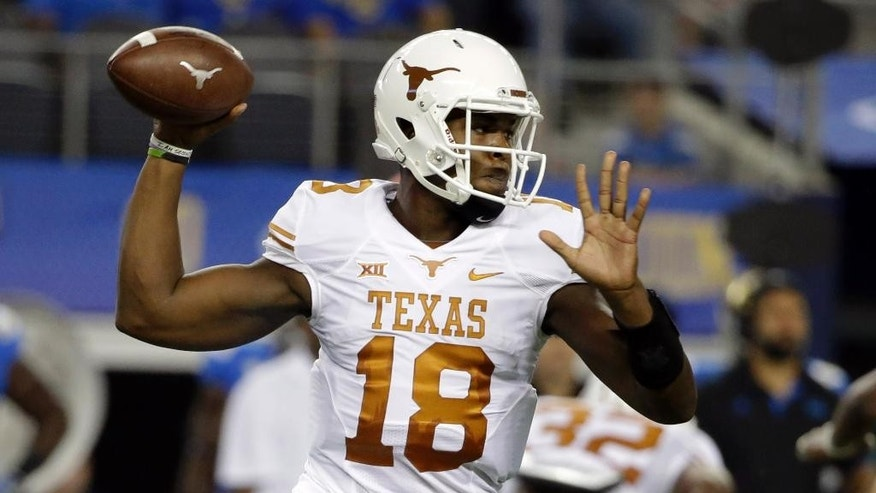 Texas quarterback Tyrone Swoopes passes against UCLA during the first half of an NCAA college football game, Saturday, Sept. 13, 2014, in Arlington, Texas. (AP Photo/Tony Gutierrez)