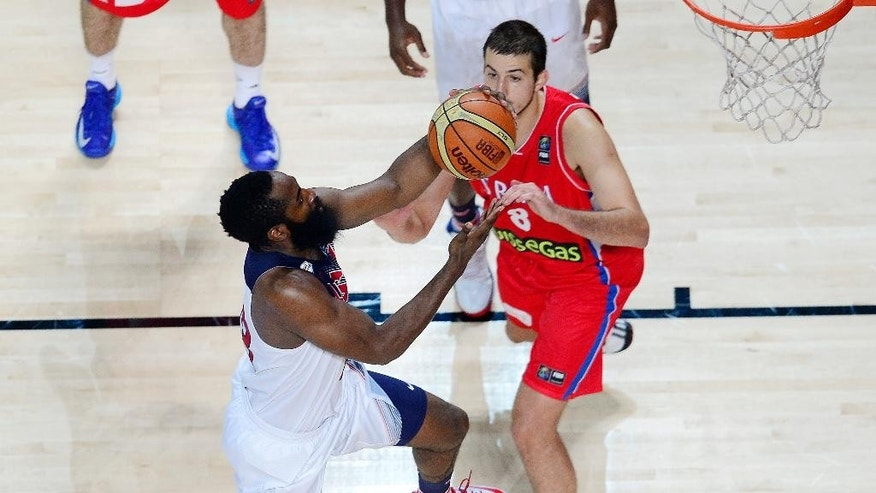 United States' James Harden, left, and Serbia's Nemanja Bjelica vie for the ball during the final World Basketball match between the United States and Serbia at the Palacio de los Deportes stadium in Madrid, Spain, Sunday, Sept. 14, 2014. (AP Photo/Manu Fernandez)