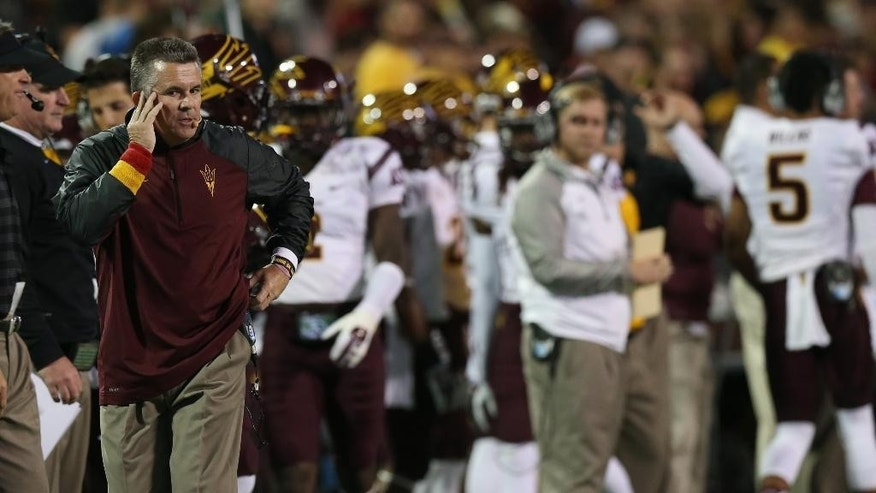 Arizona State coach Todd Graham walks on the sideline in the first quarter of an NCAA college football game against Colorado in Boulder, Colo., on Saturday, Sept. 13, 2014. (AP Photo/David Zalubowski)