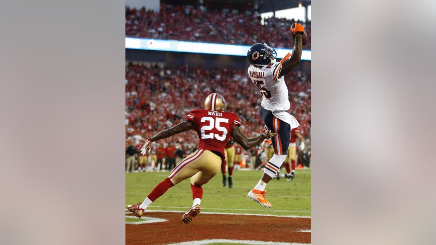 Chicago Bears wide receiver Brandon Marshall (15) catches a 17-yard touchdown in front of San Francisco 49ers strong safety Jimmie Ward (25) during the second quarter of an NFL football game in Santa Clara, Calif., Sunday, Sept. 14, 2014. (AP Photo/Tony Avelar)