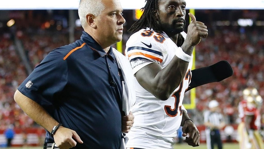 Chicago Bears cornerback Charles Tillman (33) gives a thumbs off as he leaves the field after being injured during the second half of an NFL football game against the San Francisco 49ers in Santa Clara, Calif., Sunday, Sept. 14, 2014. (AP Photo/Tony Avelar)